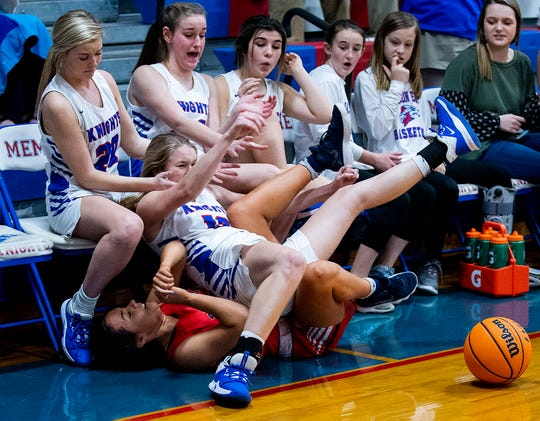 Pike's Ansley Adams (11) and Macon East's Emi Lott (12) crash into the bench while going for loose ball on the Macon East campus in Cecil, Ala., on Thursday January 30, 2020.