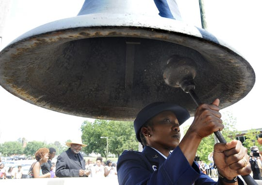 "The Memorial Bell is rung during a ceremony on the Alabama State campus honoring the 50th anniversary of the Rev. Martin Luther King Jr.'s ""I Have a Dream"" in 2013."