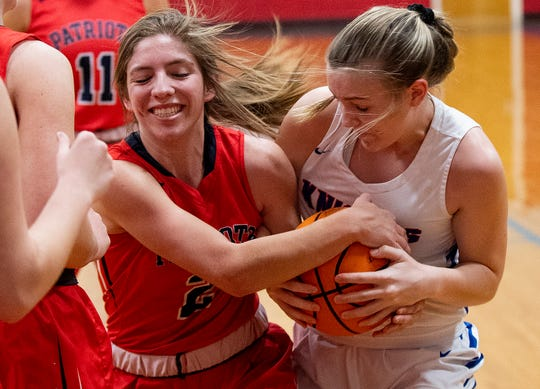 Pike's Shelby Renfroe (2) and Macon East's Maddie Ross (24) fight for the ball on the Macon East campus in Cecil, Ala., on Thursday January 30, 2020.