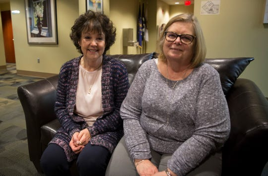 Clares Burke, right, and Linda Hayes, left, post for a photo on the third floor of city hall. Each have been with the city long enough to work for nine separate mayors.