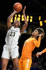 Vanderbilt forward Koi Love (23) shoots past Tennessee guard Jazmine Massengill (13) during a game Jan. 30 at Memorial Gym.