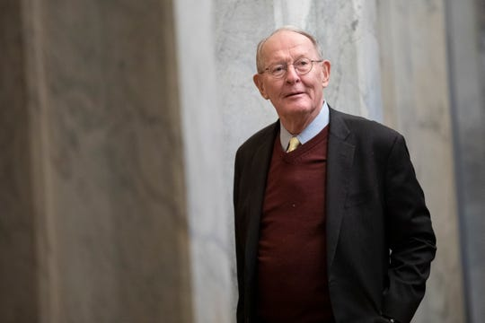 Sen. Lamar Alexander, R-Tenn., arrives on Capitol Hill in Washington, Thursday, Jan. 30, 2020, before the impeachment trial of President Donald Trump on charges of abuse of power and obstruction of Congress.