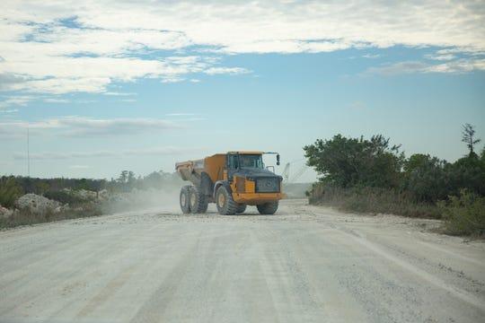 A dump truck hauls material between sites at the Bg Mine LLC facility, Friday, Jan. 30, 2020 in Bonita Springs.