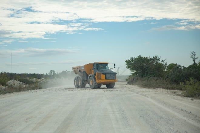 A dump truck hauls material between sites at the BG Mine LLC facility Friday, Jan. 30, 2020, in Bonita Springs.