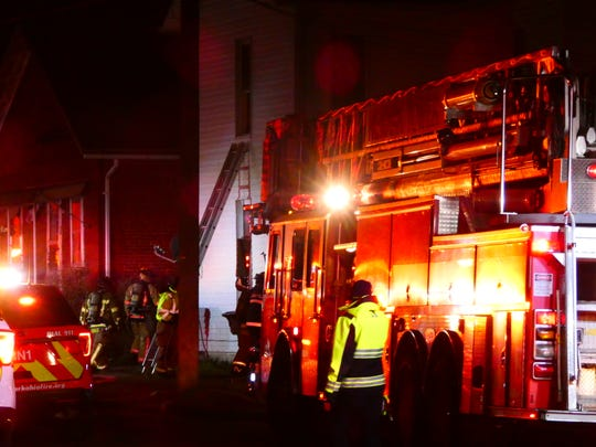 Newark Fire personnel work to extinguish a blaze on Hoover Street early Friday morning.