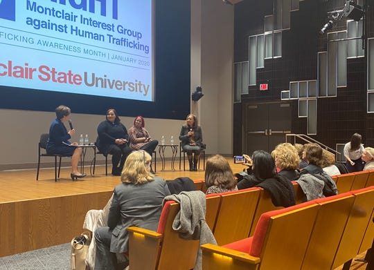 Mimi Feliciano, left, leads a discussion with GEMS leaders, center, and Montclair State professor Faith Taylor, right.