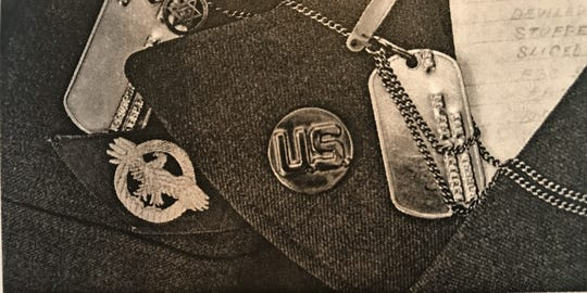 """From Robert Max's book """"The Long March Home,"""" the 96-year-old World War II veteran said he wore his Star of David and a miniature mezuzah near his dog tags."""