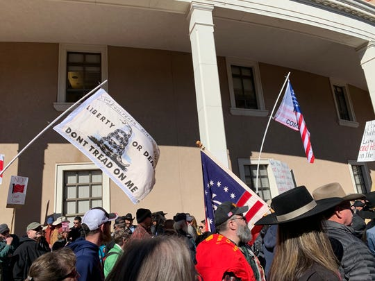 Protesters of the Extreme Risk Firearm Protection Order bill rally outside New Mexico's Capitol building in Santa Fe on Friday, Jan. 31, 2020.