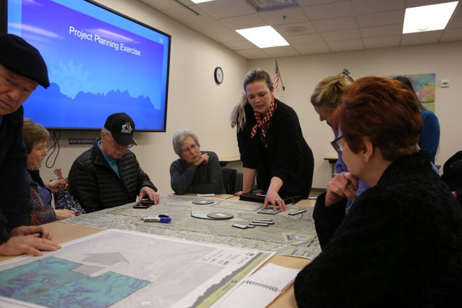 Landscape architect Norma Oder helps attendees lay out where they ideally want fields and sport courts to go at an East Mesa Public Recreation Complex public meeting Jan. 30, 2020.