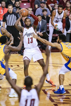 Senior power forward C.J. Bobbitt tries to pass out of a double team during New Mexico State's 61-57 home win over Cal State Bakersfield on Jan. 30.