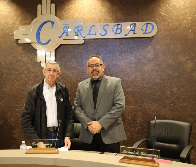 Carlsbad Mayor Dale Janway (left) and retiring City Administrator Michael Hernandez pose for one last time Jan. 30 after a special Carlsbad City Council meeting.