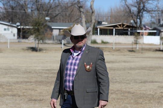 Eddy County Sheriff Mark Cage gets ready to make a speech at Carlsbad Veterans Park Friday showing support for the 2nd Amendment and opposition to firearm legislation being talked about in Santa Fe.