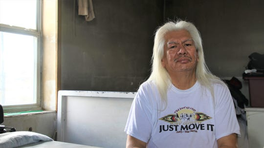 Recipient of Naschitti Chapter's wood chopping services, Bill Goldtooth, in his home in Naschitti on Jan. 27, 2020.