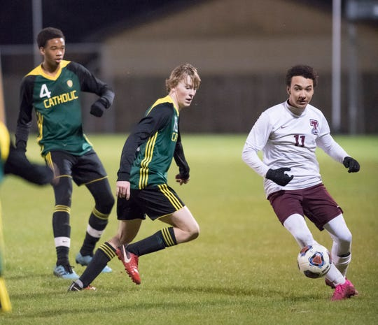 Braedon Ladd (11) moves the ball during the Tate vs Catholic boys soccer game at Pensacola Catholic High School in Pensacola on Wednesday, Jan. 29, 2020.