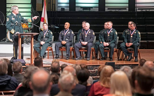 Escambia County Sheriff David Morgan speaks at a ceremony Friday at Marcus Pointe Baptist Church about the law enforcement officers who responded to the deadly shooting Dec. 6 at NAS Pensacola. Six Escambia County Sheriff's Office deputies and two police officers with the Department of Defense were honored for their actions that day. All eight received Medals of Valor and three additionally received Purple Hearts.