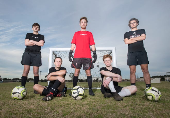West Florida High School boys soccer players (from left) Seth Clarke, Damon Brumfield, Colby Fenters, Jake Jenks, and Noah Trahan pose during practice at Ashton Brosnaham Park in Pensacola on Thursday, Jan.30, 2020.