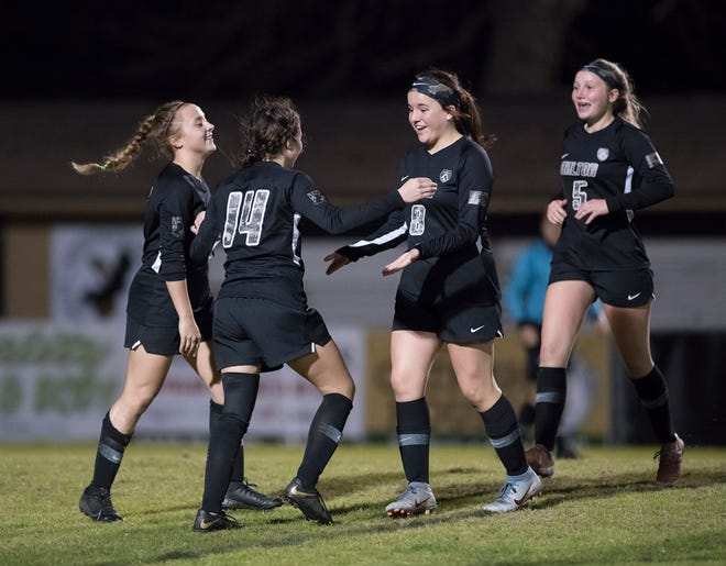 The Panthers celebrate taking a 2-0 lead during the Washington vs Milton girls soccer game at Milton High School on Thursday, Jan. 30, 2020.