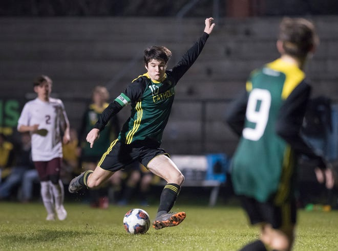 John Birdwell (10) boots the ball during the Tate vs Catholic boys soccer game at Pensacola Catholic High School in Pensacola on Wednesday, Jan. 29, 2020.