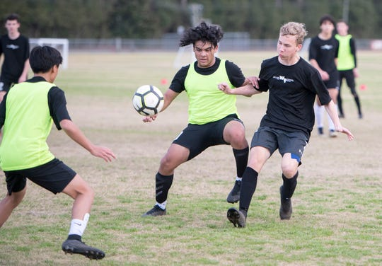 The West Florida High School boys soccer team practices at Ashton Brosnaham Park in Pensacola on Thursday, Jan.30, 2020.