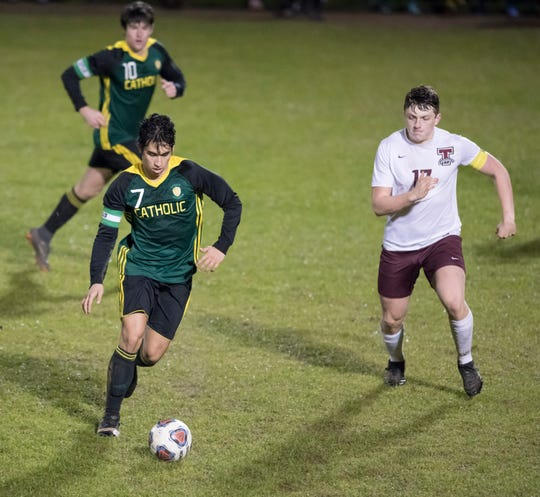 Tyler Ryals (7) dribbles the ball during the Tate vs Catholic boys soccer game at Pensacola Catholic High School in Pensacola on Wednesday, Jan. 29, 2020.