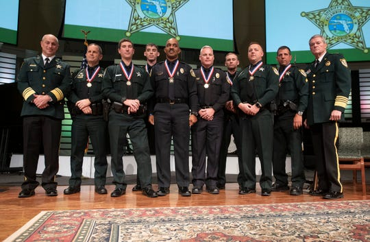 Six Escambia County Sheriff's Office deputies and two Department of Defense police officers were recognized Friday for their bravery at the NAS Pensacola shooting during a ceremony at Marcus Pointe Baptist Church.