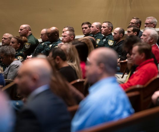 Law enforcement officers and community members gather Friday at Marcus Pointe Baptist Church for a ceremony to recognize eight law enforcement officers for their bravery during the shooting Dec. 6 at NAS Pensacola.