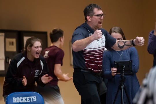 Gettysburg wrestling head coach Chris Haines reacts after Tyler Withers pins his opponent in the 126-pound bout during a District 3 Class 3A team semifinal match in Spring Grove on Thurs., Jan. 30, 2020.