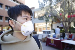 ASU student Oliver Shao wore a mask to the university's Spring Festival to celebrate the Chinese New Year. He is originally from Wuhan and said the mask makes him feel safer against the new coronavirus.