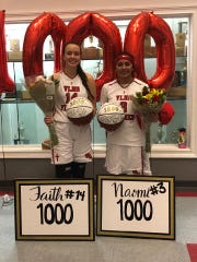 Jan. 28, 2020: Faith Measel and Naomi Fernandez hold their flowers and commemorative 1000-career point adorned basketballs after their team beat Northland Prep.