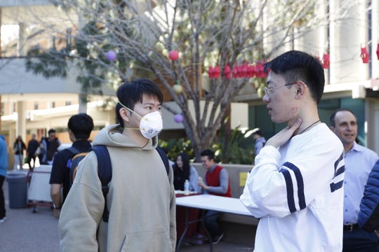 ASU student Oliver Shao (left) converses with another student, Roger Zhang, at the university's Spring Festival to celebrate the Chinese New Year. Shao and Zhang both believe the university should do more to protect students against the new coronavirus.