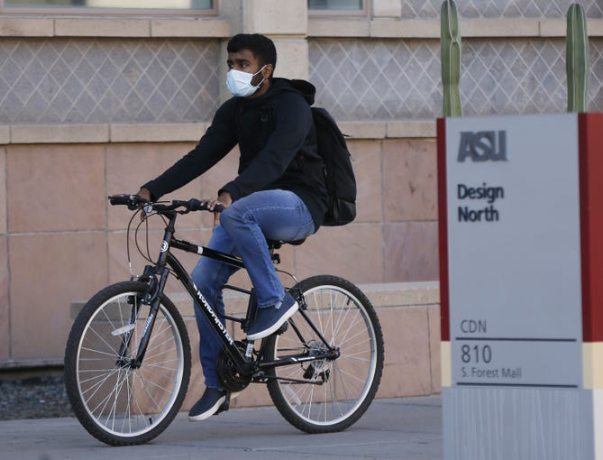 A student makes his way on Arizona State University's campus in Tempe on Jan. 30, 2020.