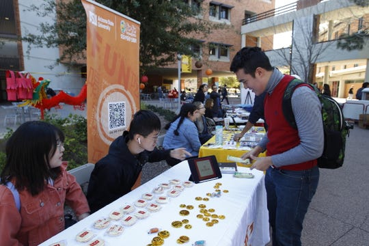 Student members of the Fun-Fun club run an informational booth at ASU's Spring Festival to celebrate the Chinese New Year. Fun-Fun club president wanted the festival to be cancelled because of concerns over the new coronavirus.