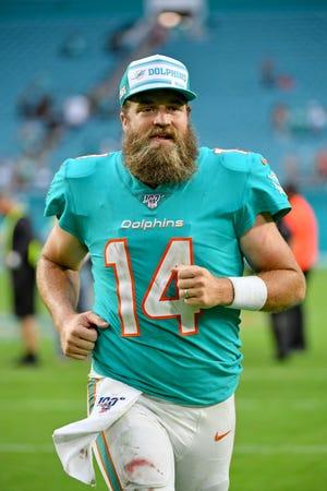 Dec 22, 2019; Miami Gardens, Florida, USA; Miami Dolphins quarterback Ryan Fitzpatrick (14) runs off the field after defeating the Cincinnati Bengals in overtime at Hard Rock Stadium. Mandatory Credit: Jasen Vinlove-USA TODAY Sports