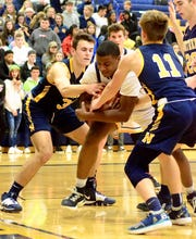 Port Huron Northern's Tyler Jamison and James DeLong fight for a rebound during a Macomb Area Conference-Gold boys basketball game on Thursday, Jan. 31, 2020, at Fraser.