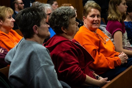 Casey Bogan, right, cheers in her seat after Irene Burns is sentenced by District Judge Michael Hulewicz Friday, Jan. 31, 2020, in the 72nd District Court in Marine City. Burns pleaded guilty to a misdemeanor of attempted animal abandonment or cruelty for four to 10 animals at a hearing in December, and was sentenced to 30 days in jail and two years' probation.