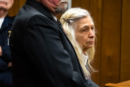 Irene Burns, 77, waits at the podium during a sentencing hearing Friday, Jan. 31, 2020, in the 72nd District Court in Marine City. Burns pleaded guilty to a misdemeanor of attempted animal abandonment or cruelty for four to 10 animals at a hearing in December, and was sentenced to 30 days in jail and two years' probation.