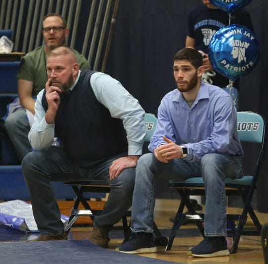 From left, John Jay's wrestling coach Jamie Weaver and assistant coach Dale White observe their wrestlers against Ramapo during Weaver's last home match on January 30, 2020.