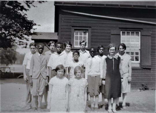Built in 1830, the Little Red Schoolhouse in Fishkill operated for 129 years on the southeast corner of today's Route 9D and Red Schoolhouse Road. Elizabeth Livingston Travis, far right, taught grades 1 to 8 in the one-room structure for 47 years.