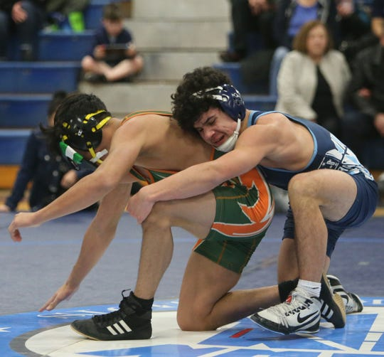 John Jay's Marcello Bernasconi wrestles Ramapo's Kevin Diaz in the 138 pound match on January 30, 2020.