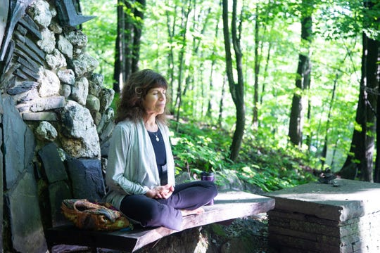 A woman meditates at the Omega Institute in Rhinebeck. Omega offers opportunities for silent retreats.