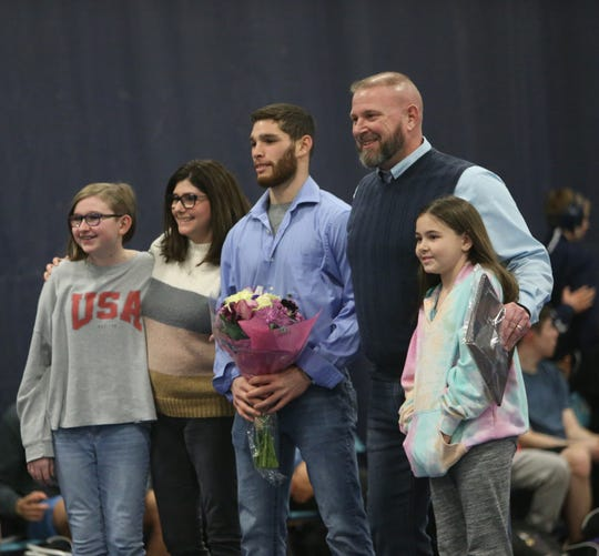 John Jay's wrestling coach Jamie Weaver , at right, with his family assistant coach Dale White before his last home match on January 30, 2020.