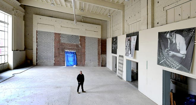 York Exponential Marketing Director Andrew Spangler walks through the future site of the Fortress Academy in the former Western National Bank in York City Friday, January 31, 2020. The academy will serve as a coding school and technology hub. Bill Kalina photo