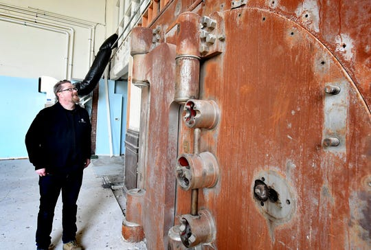 York Exponential Marketing Director Andrew Spangler talks about the original vault at the future site of the Fortress Academy in the former Western National Bank in York City Friday, January 31, 2020. The academy will serve as a coding school and technology hub. Bill Kalina photo