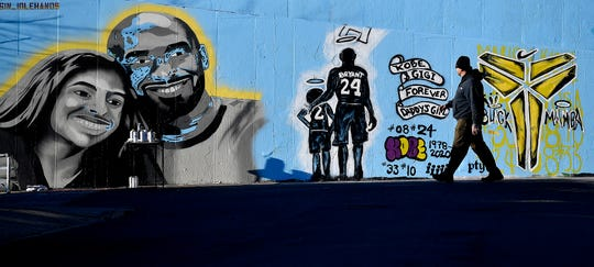 Jaysin Jefferson of the York Bomb Squad walks along the Penn Street Art Bridge while painting a tribute to Kobe Bryant and his daughter Gianna, Wednesday, January 29, 2020.John A. Pavoncello photo