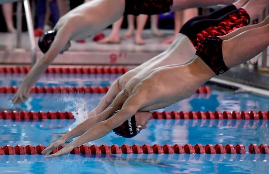 Dover's Tanner Glatfelter hits the water against Susquehannock at the start of the 200 freestyle event, Thursday, January 30, 2020.John A. Pavoncello photo
