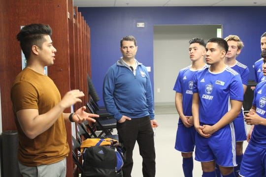 Reno 1868 FC Academy players listen to strength and conditioning coach Luis Jeronimo on Thursday.