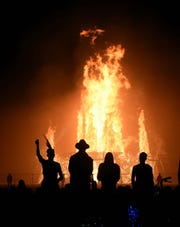 Burners watch the temple burn during Burning Man 2017