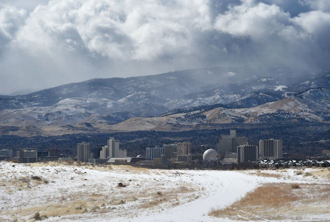 More rain and mountain snow are predicted this week as another storm rolls in. Jason Bean/RGJ Fresh snow and storm clouds are seen in Reno on a snowy Thursday morning, Feb. 22, 2018.