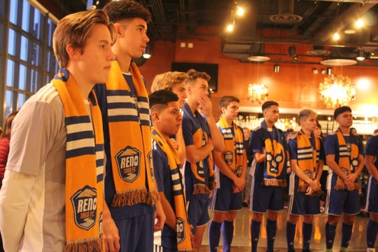 The Reno 1868 FC Academy team listens on Thursday night at Greater Nevada Field.