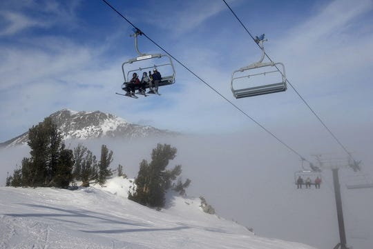 Skiers emerge from a fog and smog layer at the 9,700-foot level of Mt. Rose-Ski Tahoe in this file photo.